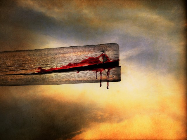 Blood dripping from cross